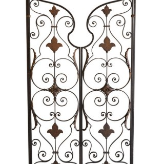 A pair of decorative American mid 20th century wrought and cast iron gates