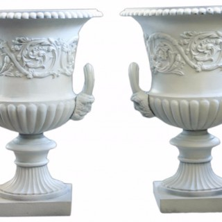 Pair of Victorian cast iron garden urns by the Handyside Foundry