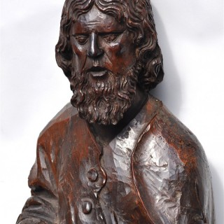 16th century carved walnut figure of an Apostle.