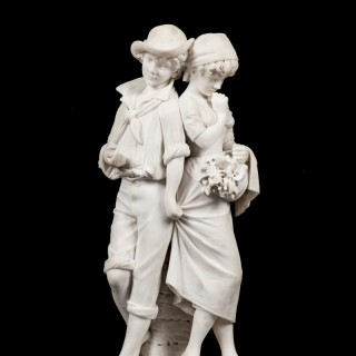 A Carrara Marble depicting two children by Cesare Lapini