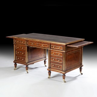 A FINE BRASS BOUND PEDESTAL DESK