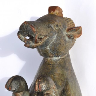 16th century carved polychrome walnut beast with its young.