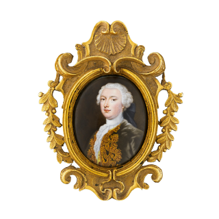 Portrait enamel of Gentleman traditionally called George William Farmer, wearing olive green and gold embroidered coat, yellow embroidered waistcoat, with a frilled jabot and powdered wig tied back with a black ribbon, c.1740
