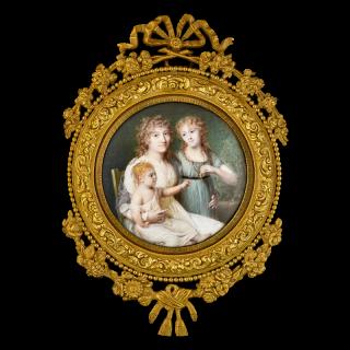 Portrait miniature of Marie Anne Marguerite, Comtesse de la Rochefoucauld (née Chéry) (1767-1849), seated, with her two children, Louise Alexandrine (b.1790) holding a portrait miniature of her father, and Henriette Marie (b.1797) on her mother's lap
