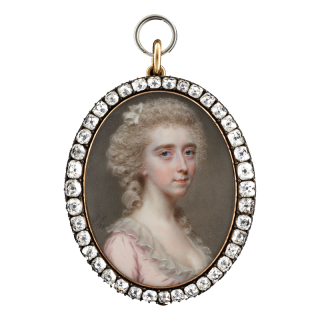 Portrait miniature of a Lady of the Darrell family, possibly Clarissa Darrell (d.1812), wearing a pink dress with high frilled white collar, her powdered hair worn up with falling ringlets and decorated with a white ribbon, 1785
