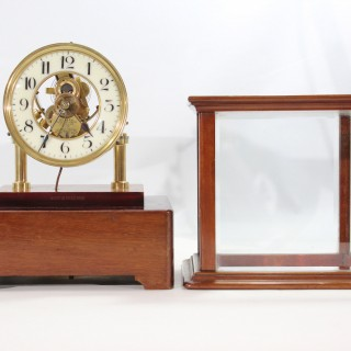 Five glass electromagnetic clock, by The Eureka Clock Company