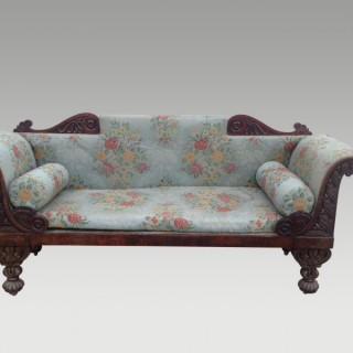 A  late Regency mahogany settee.