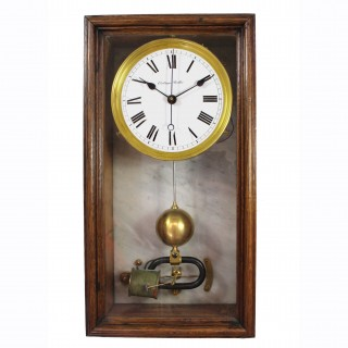 Early 20th century electromagnetic wall clock