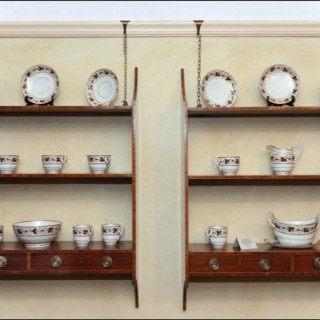 A fine pair Sheraton period mahogany hanging display shelves