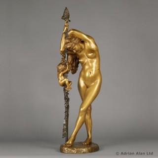 'Bacchante et l'Amour'- A Gilt and Patinated Bronze Sculpture