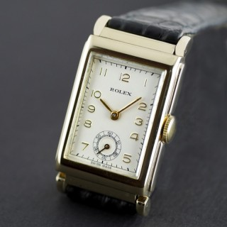 Rolex, Art Deco, Gold dated 1937 With Articulated Lugs