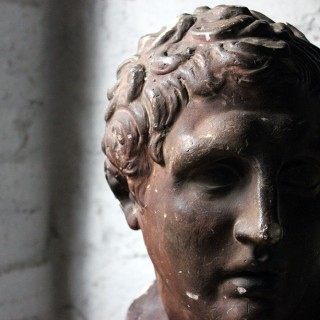 A Large & Decorative 19thC Classical Plaster Bust of The Sandal-Binding Hermes c.1890