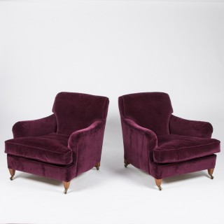 A pair of Howard style armchairs