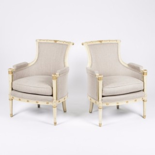 A pair of cream and gilt Swedish armchairs
