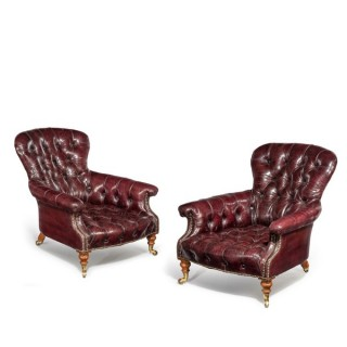 A pair of Edwardian walnut wing arm chairs,in the Queen Anne style.