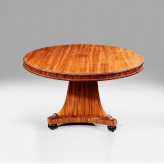 An antique Regency kingwood centre table