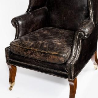 An unusual Regency mahogany sabre leg arm chair
