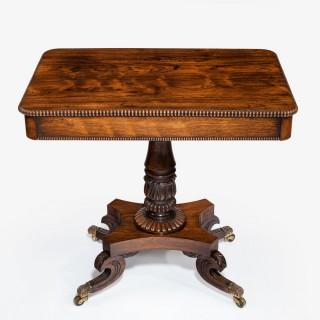 A pair of Regency rosewood side tables