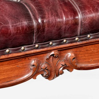 A large Victorian rosewood stool