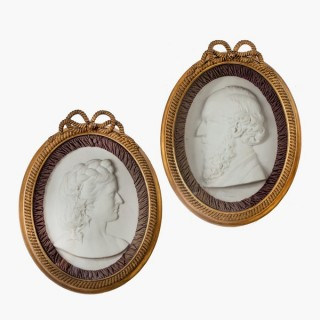 A pair of Victorian marble portrait plaques