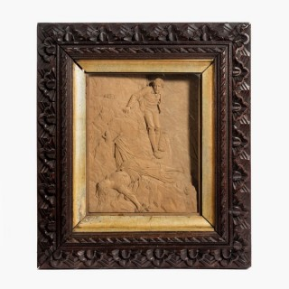 A pair of carved lime wood pictures