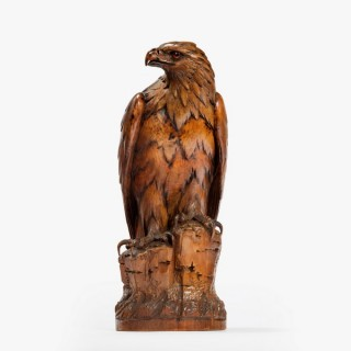 A Black Forest carved figure of a hawk