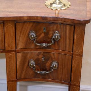 A rare small finely figured mahogany Sheraton period serpentine Sideboard