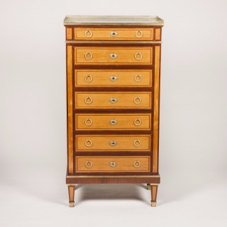 A SATINWOOD AND MAHOGANY SEMAINIER BY DURAND OF PARIS