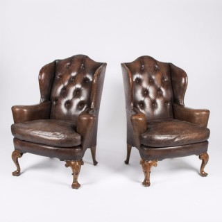 PAIR OF BUTTONED LEATHER WING CHAIRS