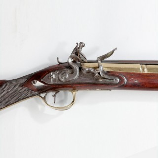 A fine Blunderbus by P Bond, with hinged bayonet and walnut stock
