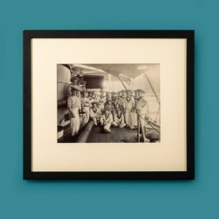Framed silver gelatin photograph of stokers on the deck of HMS Dido.