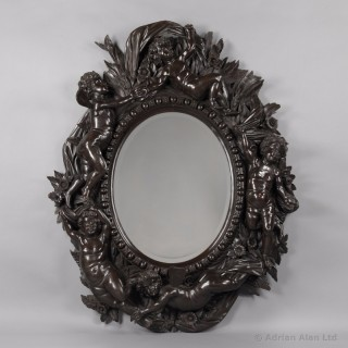 Monumental Venetian Carved Ebonised Mirror With Playful Putti
