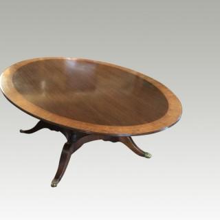 Regency style oval mahogany dining table.