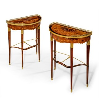 A companion pair of demi-lune bow and arrow tables by Alix