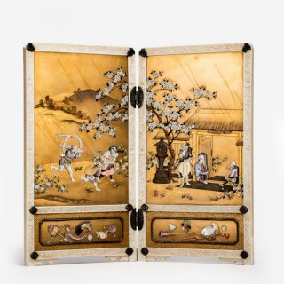 An outstanding Meiji period gold lacquer and Shibayama table screen