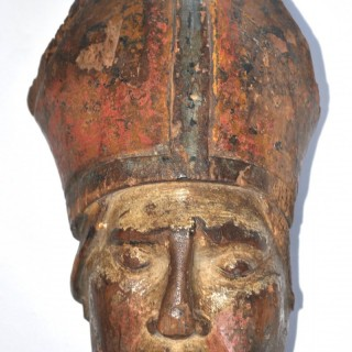 Carved Head of a Bishop.  16th century.