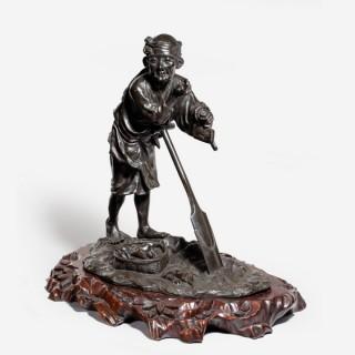 A Meiji period bronze farmer