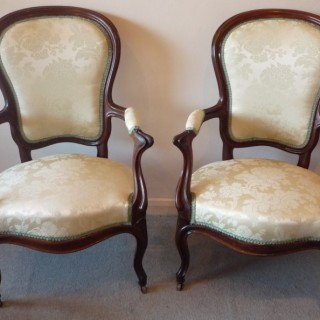 Pair of French rosewood arm chairs circa 1865