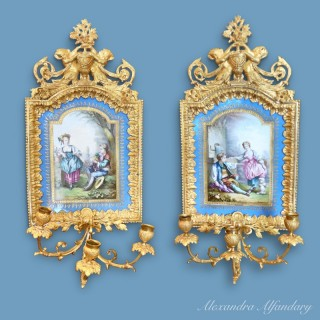 A Pair of Highly Decorative Wall Plaques in the Sevres Style