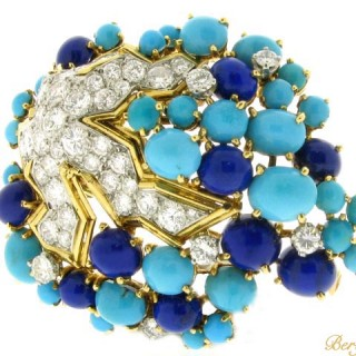 Boucheron Paris turquoise, lapis and diamond brooch, circa 1960.