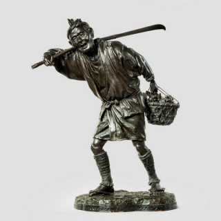 A fine Meiji period bronze of a fruit picker by UDAGAWA