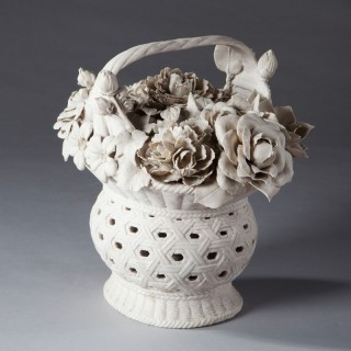 A continental biscuit porcelain model of a basket of flowers