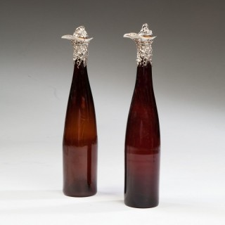A Pair Of Silver Mounted 19th C Bottles