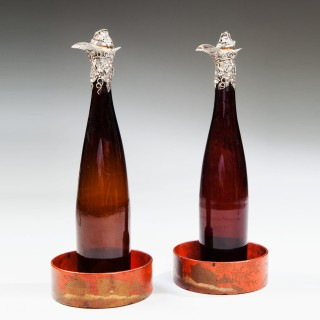 A pair of silver mounted bottles