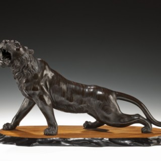 A Meiji period bronze of a snarling tiger