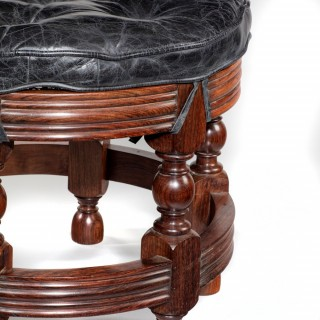 An Anglo Indian hardwood circular bergère stool by Spencer and Co Ltd, Madras