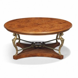 A burr elm and gilt-metal low table of regency/empire style