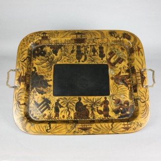 A fine regency lacquer papier mache tray by Clay of King street Covent Garden with orientalist decoration and original handles in the form of serpents.
