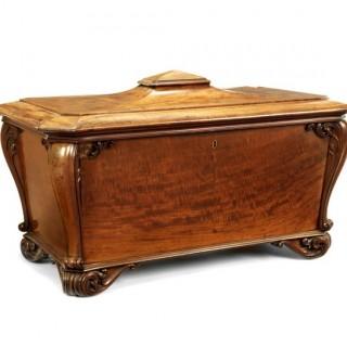A large William IV fiddleback mahogany cellaret