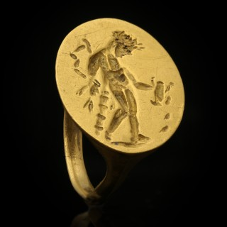 Ancient Greek gold ring with Apollo, circa 4th century BC.